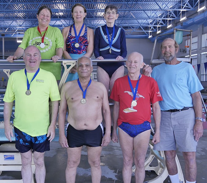 NOVA diving contestants gather on the diving board to show off their medals at the Yorktown Aquatic Center Saturday, Sept. 9. From back left: Karen Alderman, Arlington; Carol Mackela, Arlington; and Mandy Whalen, Falls Church. In front: Duane Clayton-Cox, Fairfax; Samir Salman, Vienna; Kim Alderman, Arlington; and Coach Bobby Meeks, Arlington.