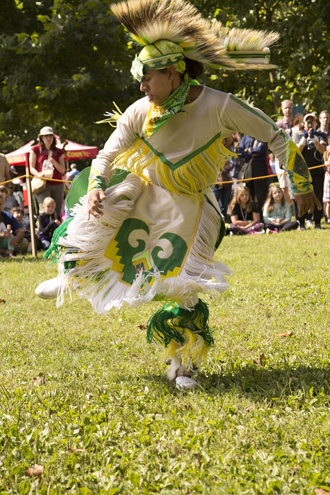 "Contemporary grass dancer Jacob Fortune performs a ""Grass"" dance during the powwow."