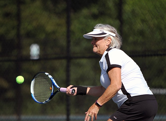 Lisa Bridges from McLean hits a forehand during her match. Bridges won gold in the 50-69 age group.