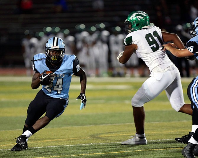 Bassie Kanu #24 carries the ball for Centreville. Kanu carried the ball 25 for 150 yards and 3 TDs in his team's 31-27 win over South County on Friday, Sept. 8.