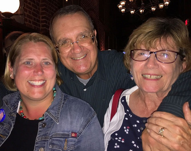 (From left) Jennifer Passey celebrates with School Board member Mitch Sutterfield and his wife Carolyn.