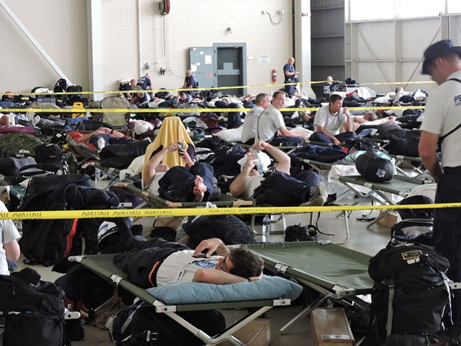 Urban search and rescue crews nationwide rest in a hangar in the heart of Georgia Friday, Sept. 8 at Robins Air Force Base prior to boarding military transport planes to Hurricane Irma disaster zones in Florida and the Caribbean.