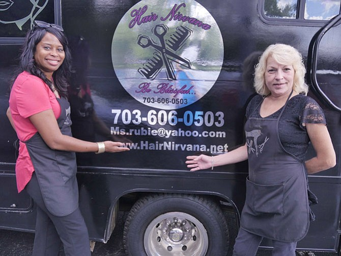 Ms. Rubie, owner/hairstylist at Hair Nirvana mobile hair salon on wheels with her assistant, Alycia Connor.