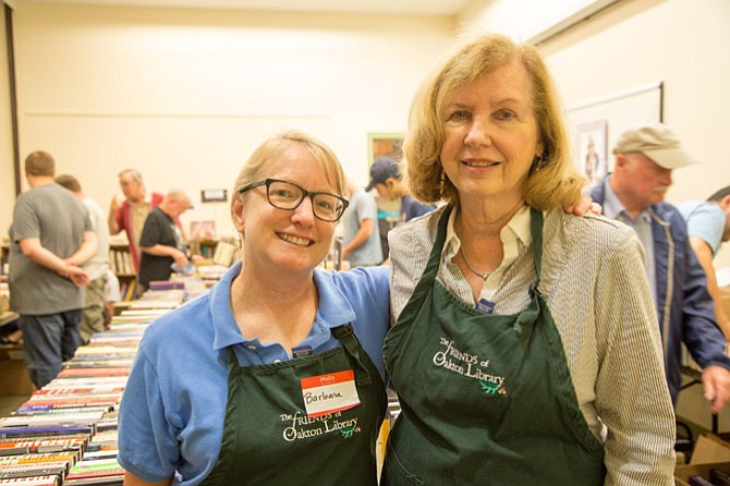 Barbra Hippe, Oakton resident and President of the Friends of Oakton Library, and Tooley Milstead, Book Sale Co-Chair, were in charge of the all-volunteer led Fall Book Sale at the Oakton Library Wednesday, Sept. 13.
