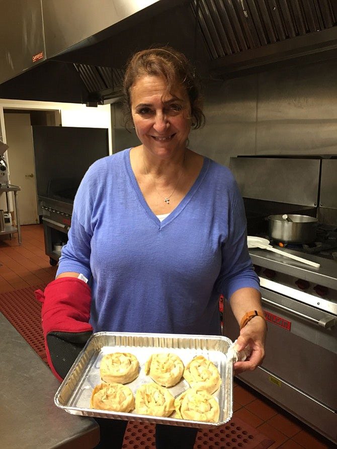 Mary Misleh holds a tray of birds nest pastries just out of the oven. Saints Peter & Paul Antiochian Orthodox Church is holding its 34th annual Middle Eastern Bazaar Sept. 22-24.