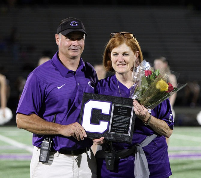 Kathleen Lynch is recognized at halftime by Corey Bowerman, director of Student Services, for her 18 years of support and dedication to Chantilly's student athletes and coaching staff.
