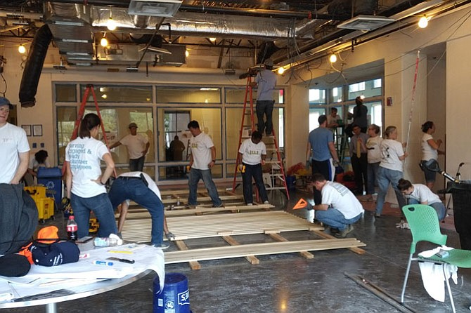 Fannie Mae and Balfour Beatty volunteers join Rebuilding Together Alexandria Sept. 14 in building a new Teen Center at the Charles Houston Recreation Center.