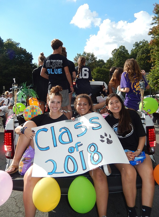 Senior Class members ride in Centreville High's homecoming parade last Friday.