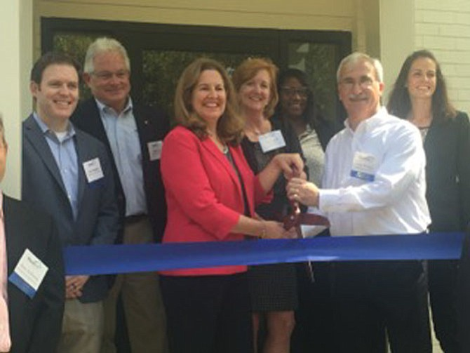 At the Sept. 19 ribbon-cutting were (from left): Jack Gallagher, Richmond American Homes; Chip Devine, Brookfield Residential; Mayor Allison Silberberg; Anne Lafond, Community Lodgings; Lynn Thomas, Community Lodgings; Jerry Berman, M/I Homes; and Kristyn Burr, HomeAid Northern Virginia.