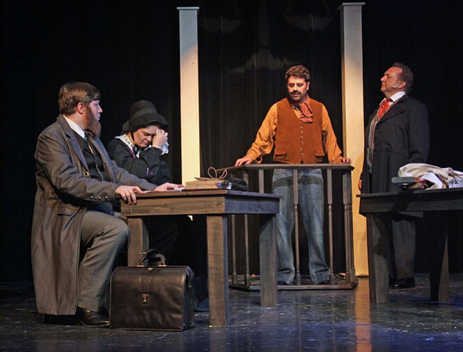 "Actors rehearse for ""The Judicial Murder of Mrs. Surratt"" at Aldersgate Church Community Theater. From left are Mytheos Holt (Frederick Aiken), Charlene Sloan (Mary Surratt), Michael Schwartz (John Lloyd) and Jim Pearson (John Bingham)."