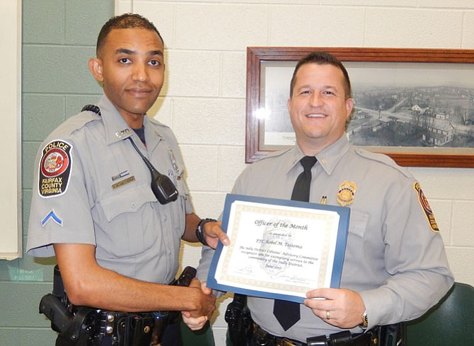 PFC Robel Tessema (left) receives his Officer of the Month certificate from the Sully District Station Assistant Commander, Lt. Ryan Morgan.