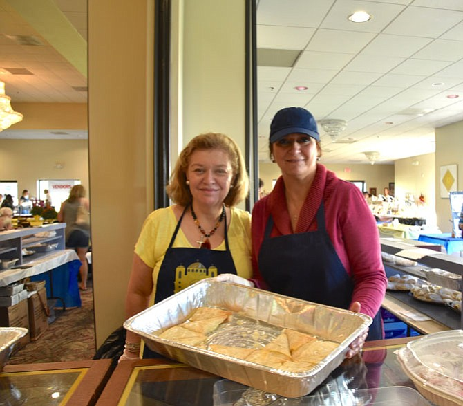 Denise Bolus and Mary Misleh show some of the pastries offered at Saints Peter & Paul Antiochian Orthodox Church's 34th Annual Middle Eastern Bazaar.