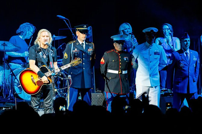 Joe Walsh pays tribute to service members of the U.S. military during the Sept. 20 VetsAid concert at Eagle Bank Arena.