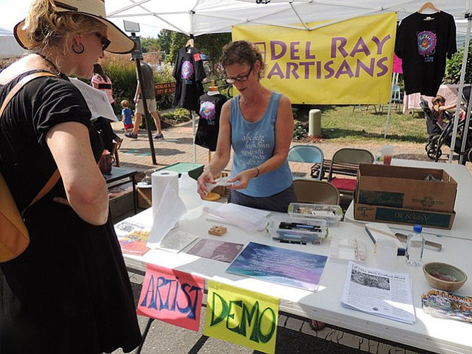 Artist Jen Nicholson leads a demonstration outside the Del Ray Artisans during last year's Art on the Avenue. This year's festival will take place Oct. 7.