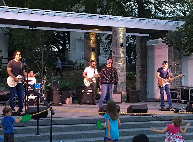 A couple thousand people attended Rock the Block, Friday night, Sept. 22, in Old Town Square in the City of Fairfax. White Ford Bronco, a '90s cover band, had people up dancing and having fun. And the sunset over downtown was gorgeous.