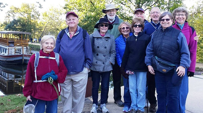 Members of the Potomac Community Village participated in a walk on the C&O Canal earlier this year. Such walks are part of the programs offering social connections for members, including (from left) Barbara Kolb, Vic Cohen, Valen Brown, Don Moldover, Phyllis Weltz, Marla Cohen, Al Weltz, Barry Taylor, Sheila Moldover, and Sheila Taylor.