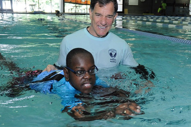 Ken Kozloff works with Sami Zachaira during an Adapted Aquatic class at Providence Rec Center.