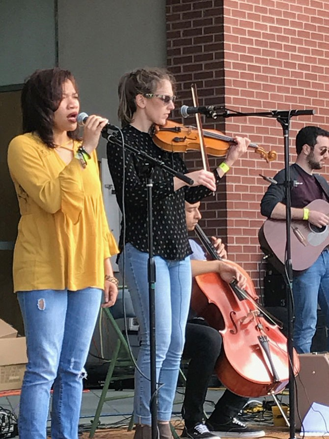 Pictured here, from left, are members of Darlingtonia: Khiya Canadiate, vocals; Mattie Sloss, vocals and violin; Gabe Hightower, cello; and Jake Wortman, guitar and ukulele. Not pictured: Mike Rivera, percussion and George Heffernan, bass.