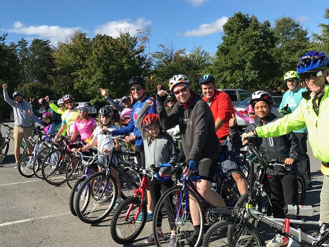 Participants in the inaugural Cupcake Bike Ride produced by Herndon Parks & Recreation let out a cheer for cycles and cupcakes as they prepare to follow the 4-mile donut-shaped loop around Herndon, stopping for treats at coffee shops and bakeries on the preplanned route.