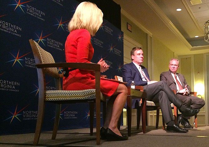 Julie Carey of NBC4 moderates a discussion between U.S. Sen. Mark Warner and U.S. Sen. Tim Kaine at the Falls Church Marriott Fairview Park.