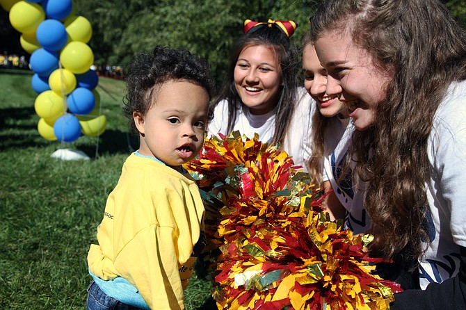 Bishop Ireton cheerleaders greet two-year-old Oliver Humes from Alexandria during the walk.