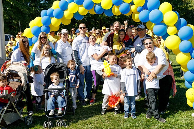 Team Emma Strong poses for a photo following the DSANV Buddy Walk Oct. 1 in Fairfax. Emma Laukhuf, daughter of Kent and Dana Laukuf, was born last December with Down syndrome.