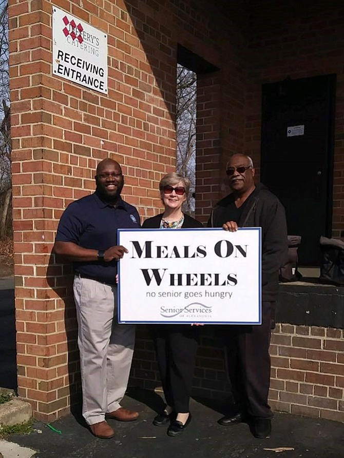 Senior Services of Alexandria executive director Mary Lee Anderson, center, delivers Meals on Wheels with City Councilman John Chapman and past SSA board chair Lynnwood Campbell. Meals on Wheels is one of many services available to seniors living in Alexandria.