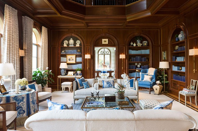 Inspired by the library of New York socialite Brooke Astor, designer Kelley Proxmire used shades of blue against dark wood in the library of the D.C. Design House.
