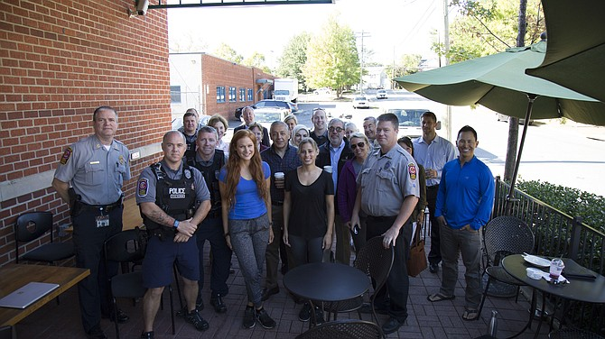 "Police officers from the Fairfax County Police Department McLean District Station visited with the community outside on the patio at Greenberry's Coffee Company in McLean on the morning of Wednesday, Oct. 4, for ""Coffee with A Cop"" day."