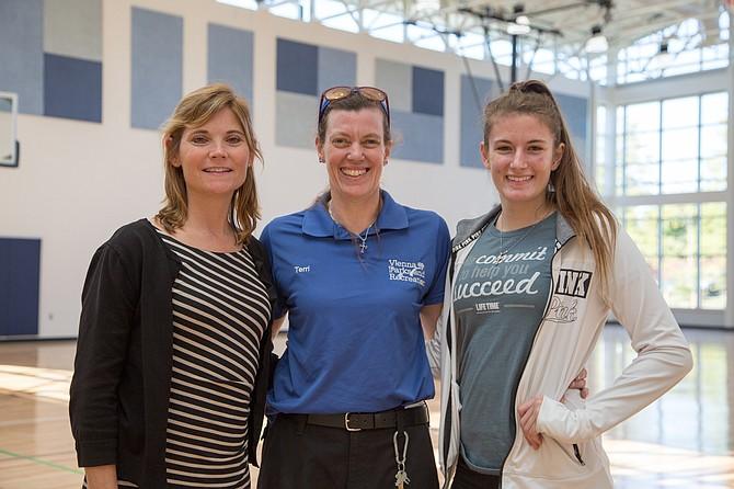 From left: Leslie Herman, Vienna resident and director with Vienna Parks and Recreation, with Terri Tufano, senior at Centreville High School, and her mother Terri Tufano, custodian, at the newly renovated Vienna Community Center Wednesday, Oct. 4.