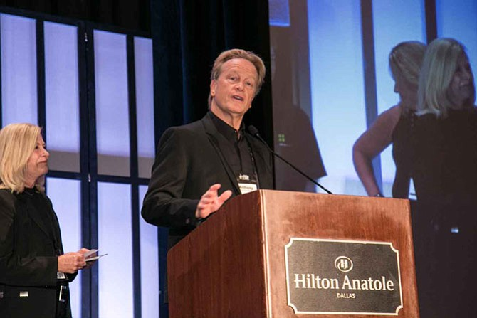 Elizabeth Wilder and Anthony Wilder give remarks after receiving the Hall of Fame award from The Great Game of Business.