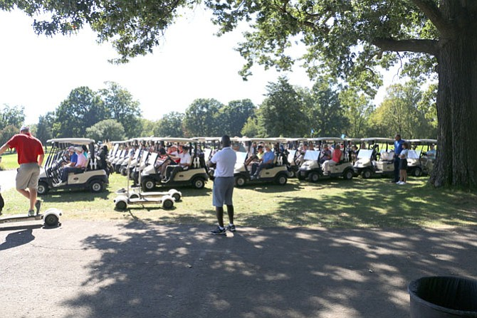 Tee Time: Golfers in teams of four line up in golf carts for a shotgun tee off at Reston National Golf Course on Monday, Oct. 2, for the Rescue Reston third Annual Golf Classic.