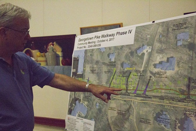 Fairfax County Department of Transportation Environmental Specialist Doug Miller shows residents a rendering of the Phase IV.
