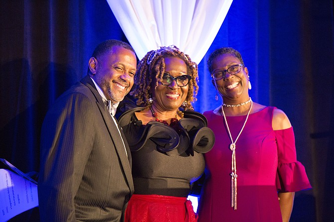 Mark Moore (left) and Brenda Moore (right) pause for a picture with Publisher and CEO of VA WOMAN Magazine Group Dorri Scott, who served as the 2017 Raise the Region Gala Mistress of Ceremonies (center), after being honored with the 2017 Community Leadership Award.