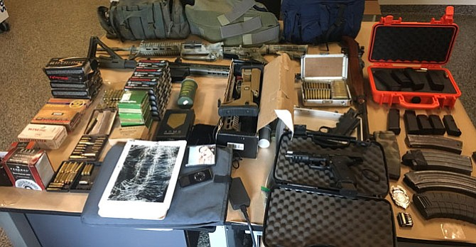 A cache of firearms and more than 200 items were recovered after an investigation into a rash of items being stolen from parked vehicles in north Reston.