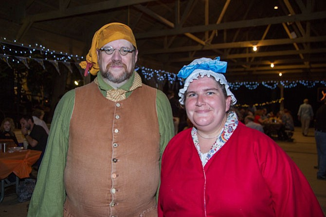 J. D. Engle, events manager at Claude Moore Colonial Farm, and Lisa Berray were both dressed in traditional costumes from the 1800s for the silent auction and celebration Saturday night, Oct. 7 at Claude Moore Colonial Farm.
