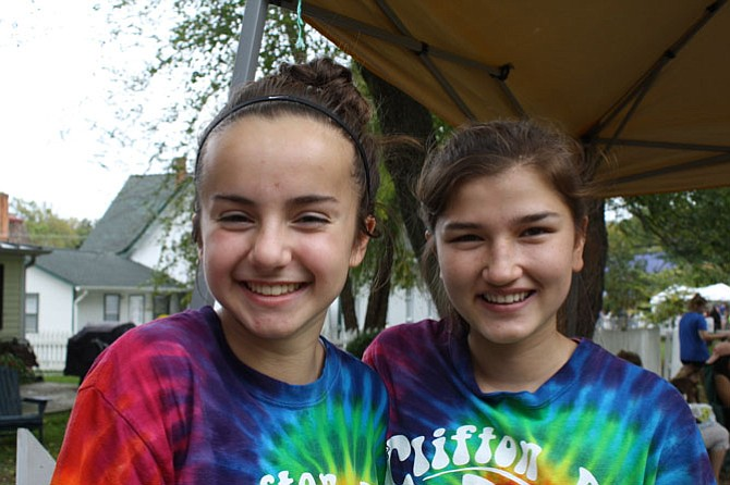 Volunteers Carly Daniels and Allison Best are sporting the Clifton volunteer staff tie-dyed shirts as they earn some community hours for South County Middle School where they are in the eighth grade.
