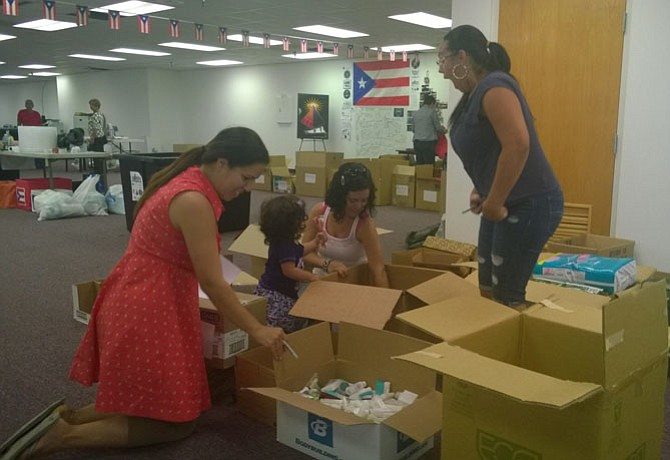 While their kids are at school on a Friday afternoon, Fairfax County mothers organize boxes of toiletries Oct. 6 before these donated supplies are shipped from the collection center at 14320-A Sullyfield Circle in Chantilly to storm survivors in Puerto Rico.