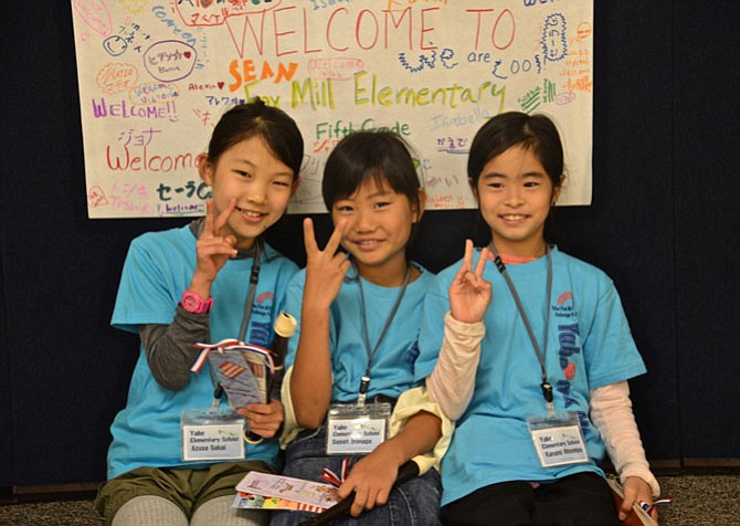 Azusa Sakai, Sayuri Iyonaga and Kanami Ninomiya share their hopes for peace after the special assembly at Fox Mill Elementary, where the young trio and seven of their school chums have been visiting as exchange students, hosted by families of Fox Mill students.