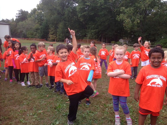 The kindergarteners and first graders ran together.