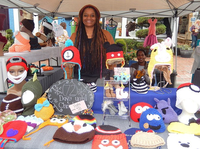 Andrea Scott of N the Loop sells handmade, crocheted caps, scarves and ponchos. Seated is Tanisha Nicholson.