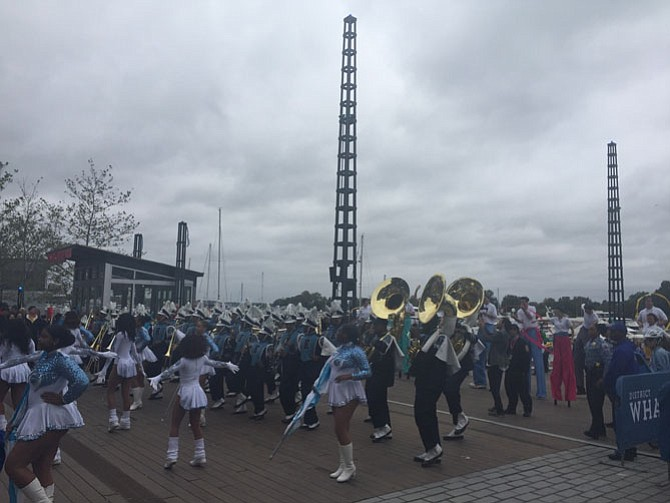 Marching bands and dance groups perform at The Wharf opening ceremonies.