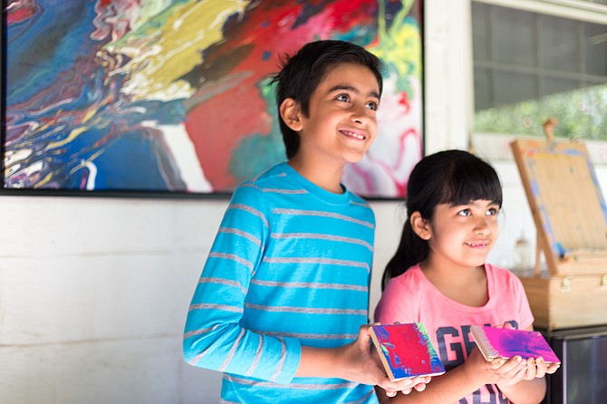 Brother and sister, Shawn Sidhu, 9, and Sarena Sidhu, 6, with their spin-art that they made with the help of Great Falls artist, Linda Cameron, for the Great Falls Studio Arts Tour Saturday.