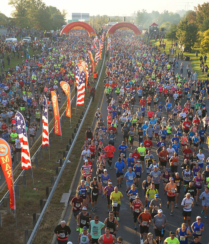 More than 30,000 runners crowd the streets of Arlington at the start of the 42nd annual Marine Corps Marathon Oct. 22.