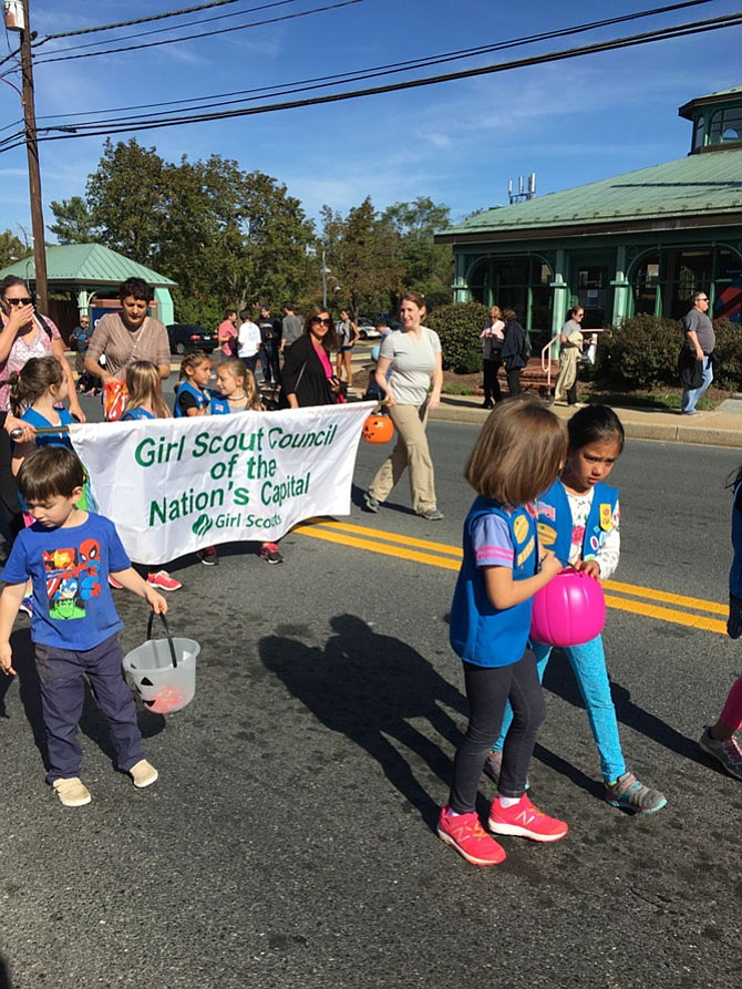 Girl Scouts from Wayside Elementary School march in the annual Potomac Day parade Saturday.