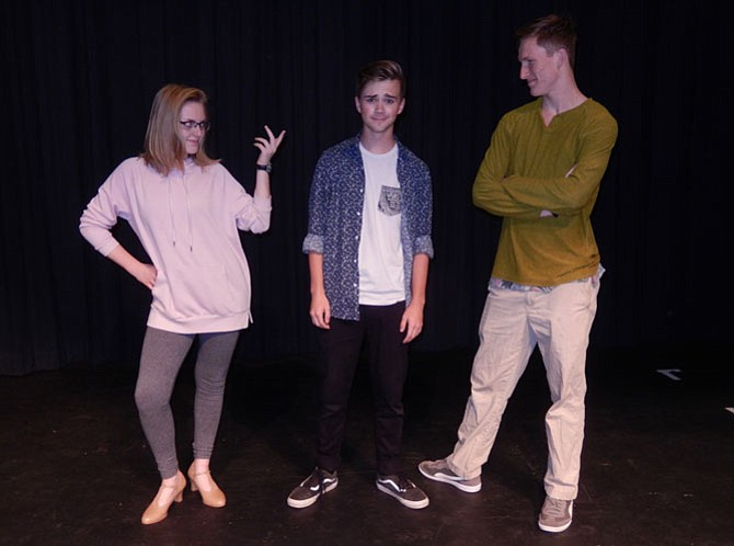 As Pippin, Jack Hopewell (in center) is being persuaded by Sydney Cluff and Nick Daché to find something to make his life extraordinary.