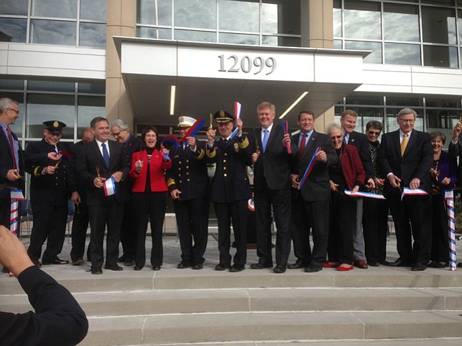 All hands on the golden scissors to open the new Public Safety Headquarters.