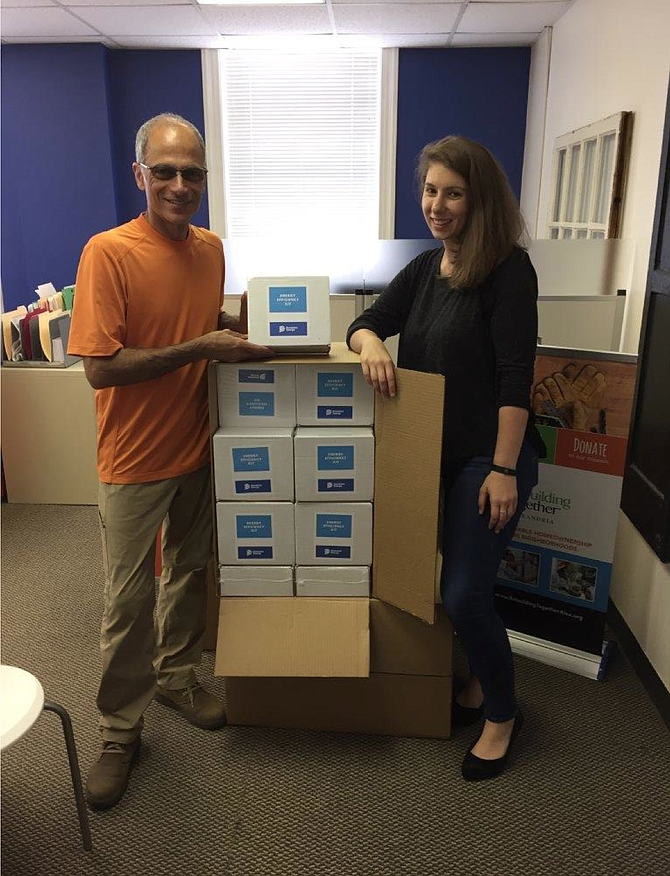 Director of Programs Haig Paul and Outreach Manager Breanne Driscoll of Rebuilding Together Alexandria, in partnership with Dominion Energy, will deliver 100-plus energy efficient kits to city residents this year.