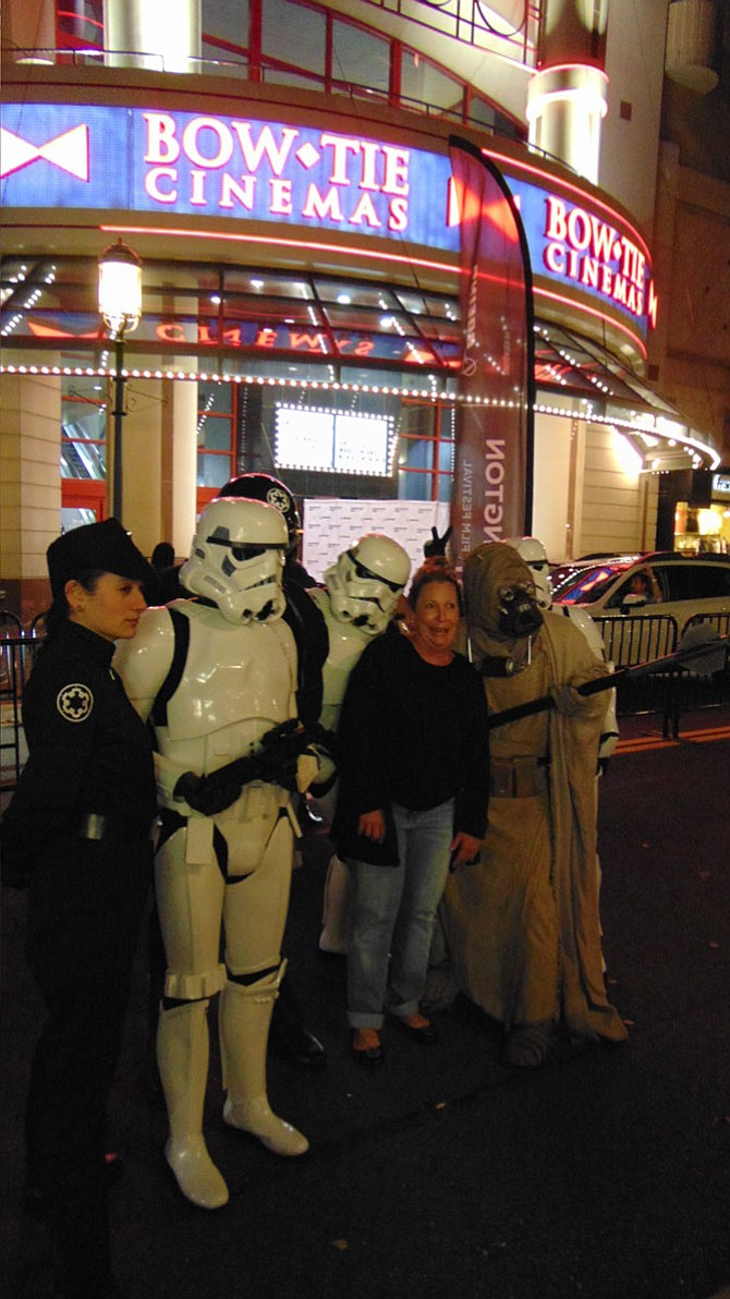 "Georgia Cassedy of Reston with the all-volunteer 501st Legion dressed as ""Star Wars"" characters at the film premiere of ""Clive Davis: The Soundtrack of Our Lives,"" during the Washington West Film Festival at the Bow Tie Cinemas at Reston Town Center."
