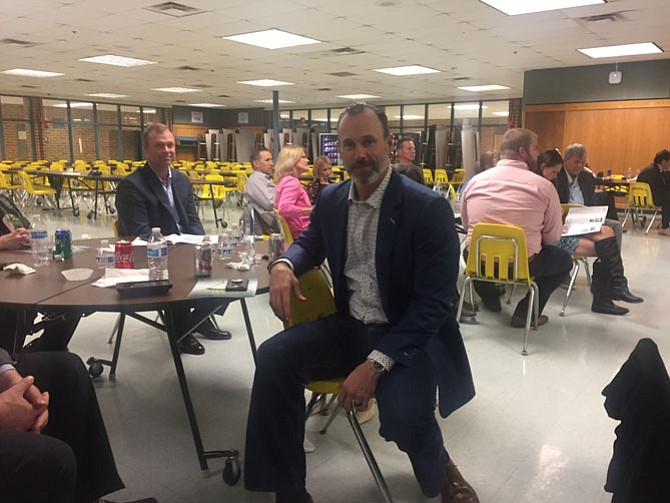 David VanDyke waits for his turn to speak at the Robinson Secondary School's athletic hall of fame event.